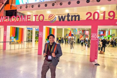 Posing behind the World Travel Market 2019 sign